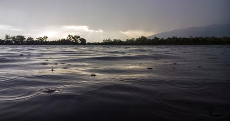 Rain in mountain lake