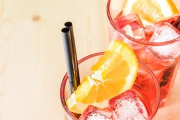glass of spritz aperitif aperol cocktail with orange slices ice