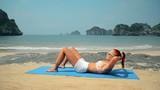 Young woman doing fitness yoga