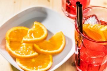 glass of spritz aperitif aperol cocktail near plate oranges