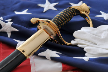 White gloves, sabre, and American flag. Symbols of freedom.
