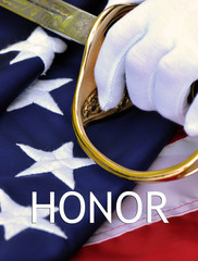 Honor - white gloved officer hands with sabre and flag.