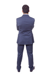 Full body of a business man standing from the back, isolated on
