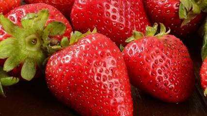 Pan across ripe red strawberries
