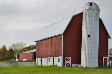 Traditional Red Barn and grain storage silo