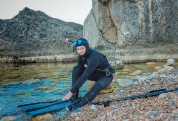 man in a suit underwater hunter