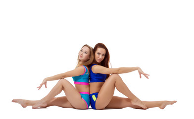 Charming female athletes posing looking at camera