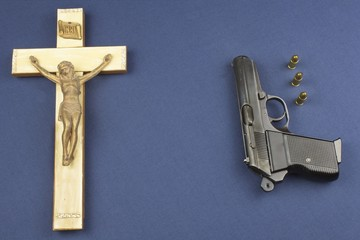 A wooden crucifix with the lettering INRI and gun