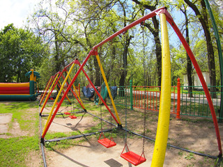 Children's playground with swings in the park