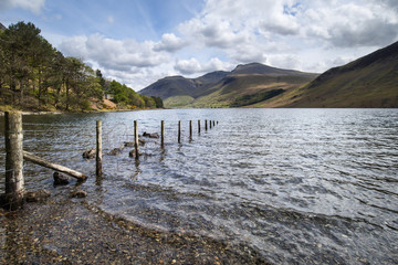 Stunning landscape of Wast Water with reflections in calm lake w
