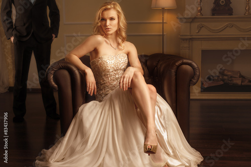 Luxury woman in rich interior Poster
