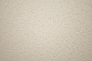 Beige grained wall background or texture