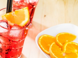 glass of spritz aperitif aperol cocktail with orange slices