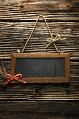 Brown wooden frame on brown wooden background