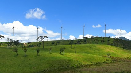 Wind turbines on green hills - wind farm in Sri Lanka 4k