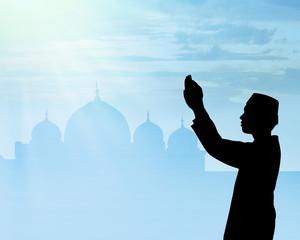 Silhouette of muslim people praying