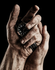 Clock in male hands