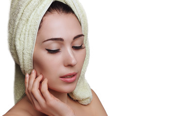Woman in towel turban on white background. Skin care.
