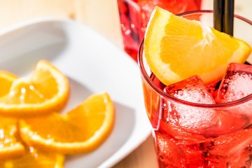 view of glass of spritz aperitif aperol cocktail and orange