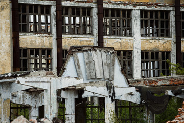 A ruined building of a plant with a row of empty windows
