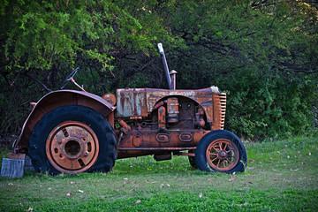 old vintage tractor standing derilict