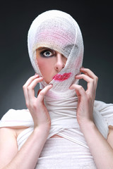 Beauty Concept of Heavy Makeup Seeping Through Gauze