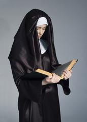 Nun with bible