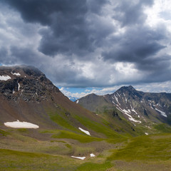 mountain valley under a dense clouds