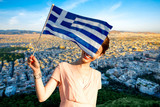 Woman with Greek flag on Athens cityscape background