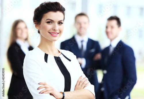 Poster Face of beautiful woman on the background of business people