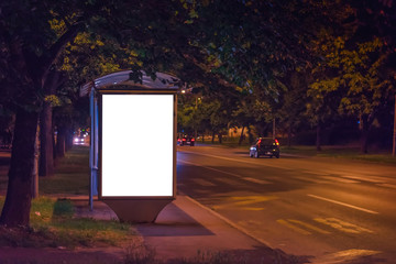 Blank Bus Station Billboard at Night