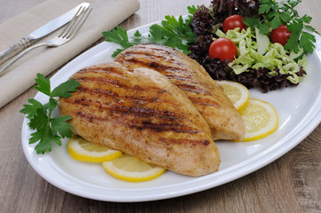 chicken grilled with a salad on a plate