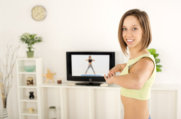 Woman Exercise In Front Of TV