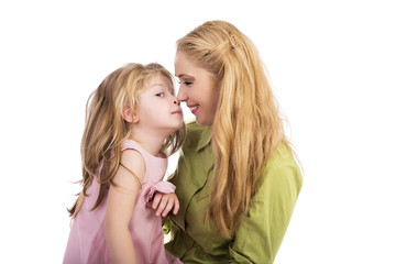Mother kissing and playing with her lovely daughter