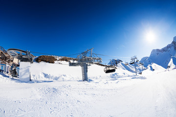 Ski resort panorama with piste and skilift ropeway