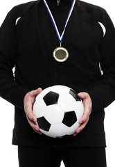 champion holding soccer ball