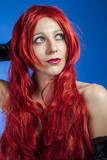 Haircare, attractive woman with huge red mane, blue chroma poster