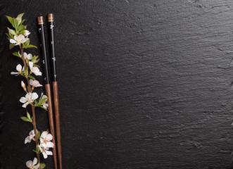 Japanese sushi chopsticks and sakura blossom
