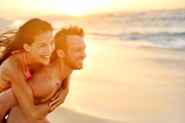 Lovers couple in love having fun on beach portrait