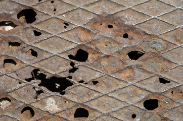 Rust on steel panel with holes