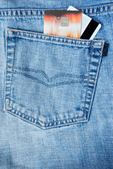 credit card in the pocket of jeans. close-up