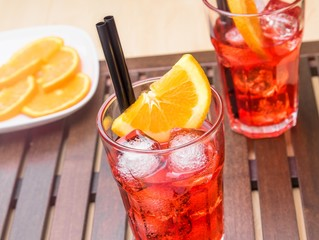 glasses of spritz aperitif aperol cocktail and orange slices