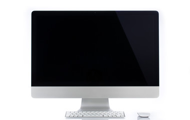 Desktop computer with wireless keyboard and mouse.