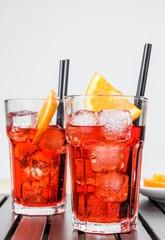 glasses of spritz aperitif aperol cocktail and orange, ice
