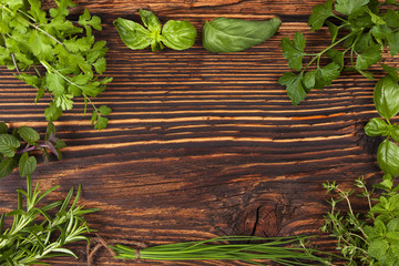 Culinary herbs background with copy space.