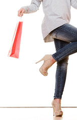 Woman legs with red shopping bags isolated