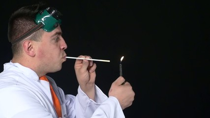Chemist breathes fire through a straw, Slow motion