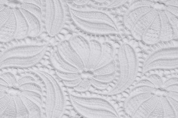White lace over white background