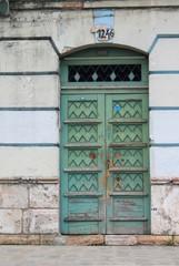 Weathered blue-green door in Cuenca, Ecuador