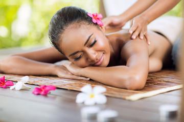 professional masseur doing massage of female